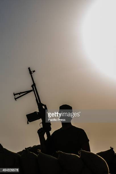 Peshmerga soldiers watch and wait for the Islamic state to attack The Khazir front line which is 30km from Erbil the capital city of Kurdistan marks...