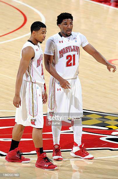 Pe'Shon Howard and Terrell Stoglin of the Maryland Terrapins talk during the game against the Radford Highlanders at the Comcast Center on December...