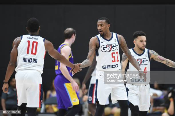 Pe'Shon Howard shakes hands with Jordan McRae of the Capital City GoGo during a game against the South Bay Lakers on December 13 2018 at UCLA Heath...