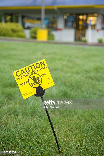 pestcide caution sign on the grounds of burger king in greenfield, ma - burger king stock pictures, royalty-free photos & images