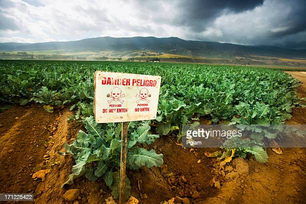 Pesticide warning sign on fertile farm land