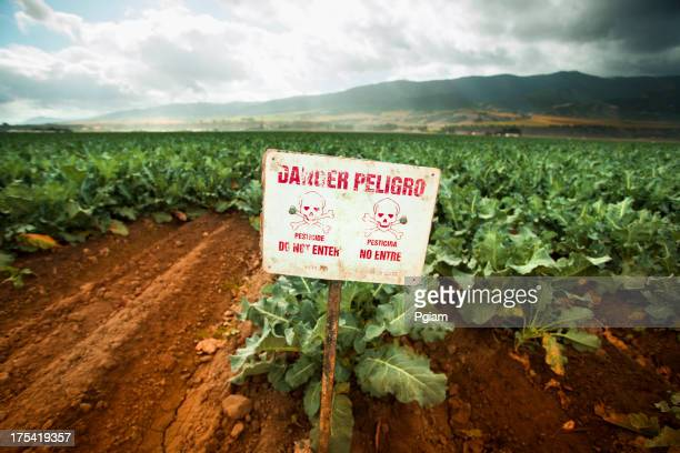 Pesticide warning sign on fertile farm land