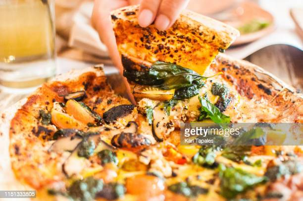 pesto and mushroom pizza - vegetarian pizza stock pictures, royalty-free photos & images