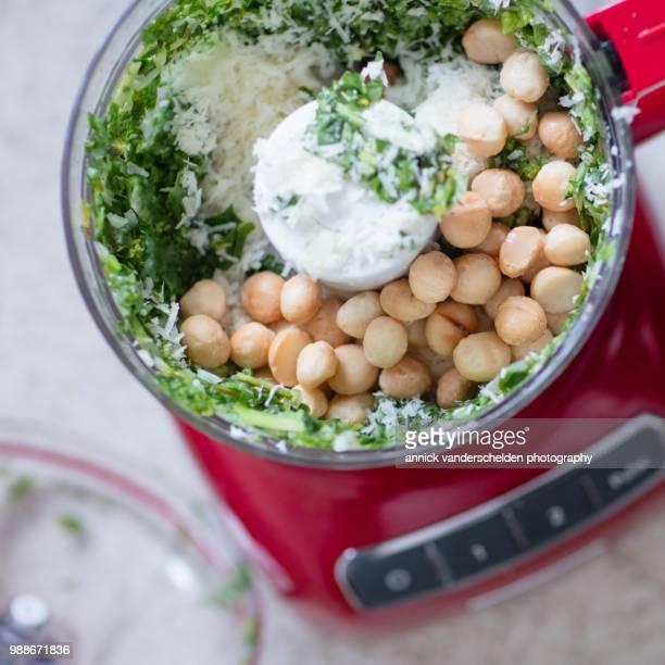 Pesto preparation with macademia nuts.