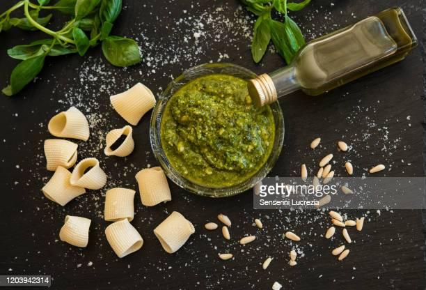 pesto sauce, basil, pine nuts, rigatoni, cheese flakes - pesto stock pictures, royalty-free photos & images