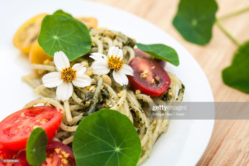 Pesto Spaghetti with Cosmos and Nasturtiums : Stock Photo