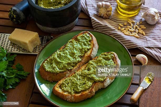 pesto spread on bread - pesto stock pictures, royalty-free photos & images