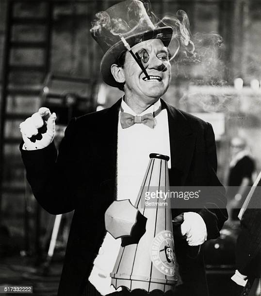 Toting a movie director's megaphone, complete with umbrella, Burgess Meredith reprises his special guest villian role of Penguin in the three-part...