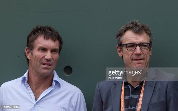 Pet Cash and Mats Wilander are watching the match of Dominic Thiem of Austria and Novak Djokovic of Serbia during the quarterfinals at Roland Garros...