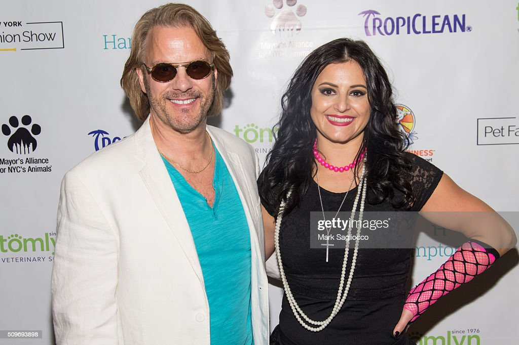 Pet Media PR President Gregg Oehler (L) and former gymnast Gold Medalist Dominique Moceanu attend the 12th Annual NY Pet Fashion Show at Hotel Pennsylvania on February 11, 2016 in New York City.