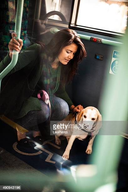 Pet owner and her dog inside a public bus