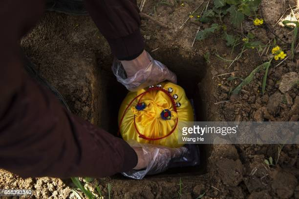 A pet owner holds a funeral for their dog Jaili who died at the age of 19 Wangzai pet cemetery on March 27 2017 in Wuhan Hubei province China Wangzai...