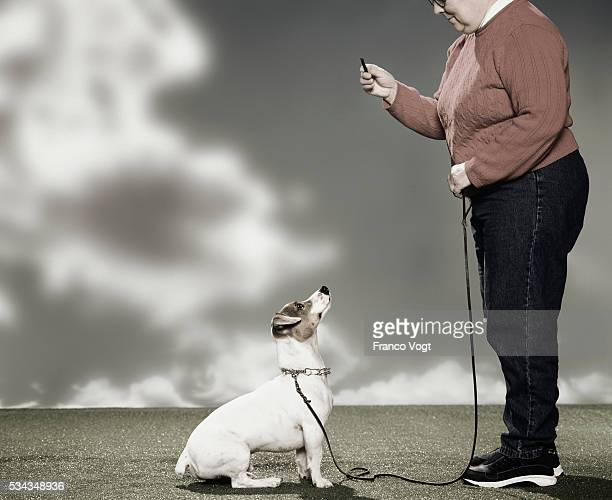 Pet Owner Training Her Dog