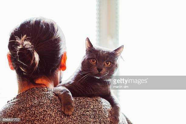 Pet owner with cat