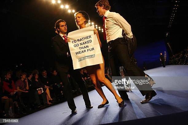 Peta demonstrator is stopped on the catwalk at the Christian Lacroix Fashion show during Paris Fashion Week F/W 2007/08 at Espace Ephemere jardin des...