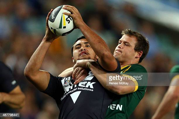 Peta Hiku of New Zealand is tackled by Josh Morris of Australia during the ANZAC Test match between the Australian Kangaroos and the New Zealand...