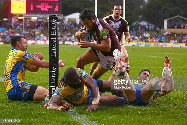 Peta Hiku of the Eagles beats the Eels defence to score a try during the round 24 NRL match between the Manly Warringah Sea Eagles and the Parramatta...