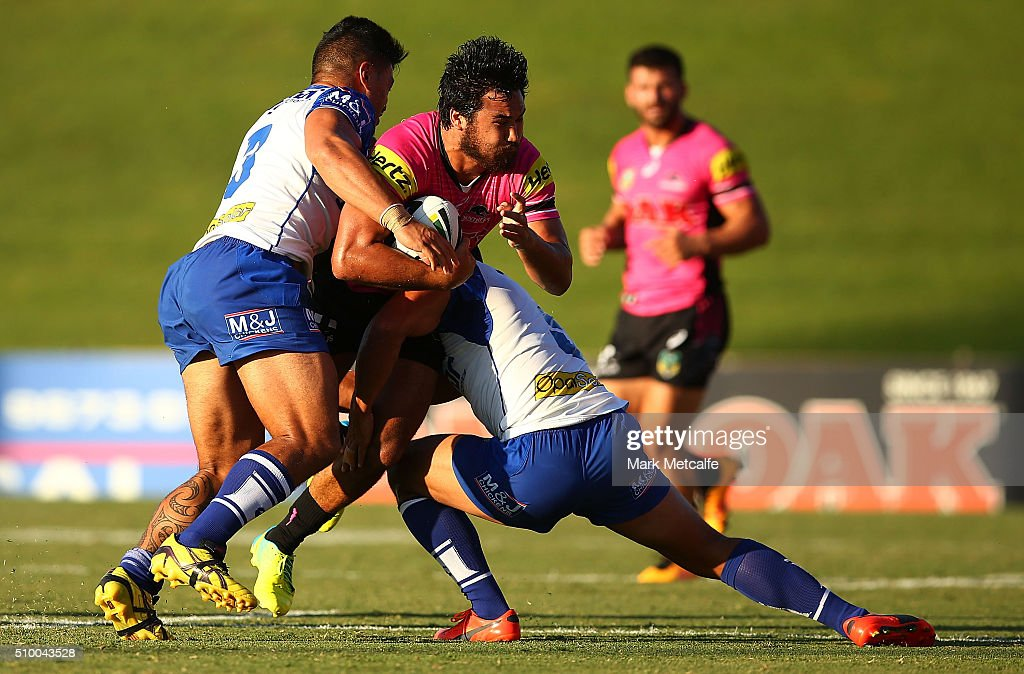Peta Hiku of the Panthers is tackled during the NRL Trial match between the Canterbury Bulldogs and the Penrith Panthers at Pepper Stadium on February 13, 2016 in Sydney, Australia.