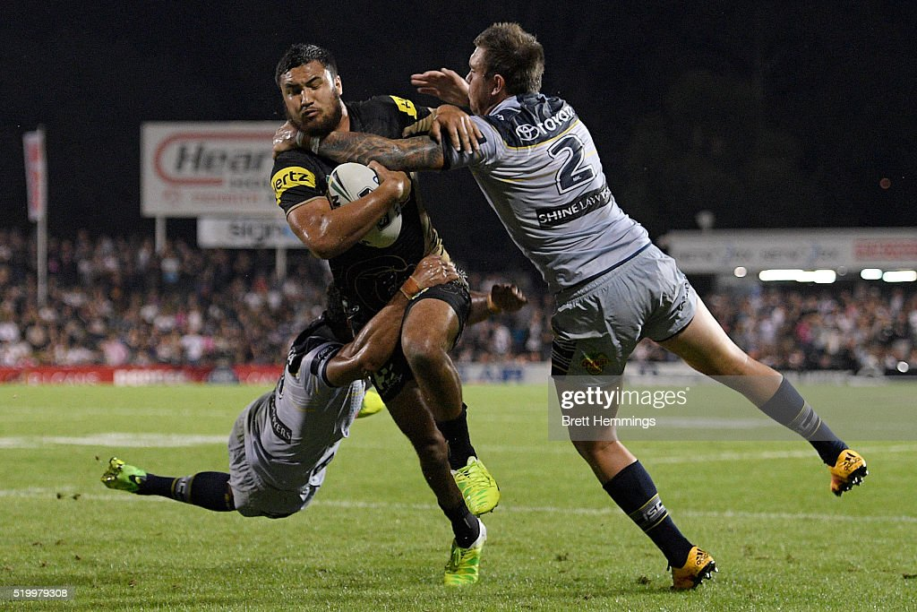 Peta Hiku of the Panthers is tackled during the round six NRL match between the Penrith Panthers and the North Queensland Cowboys at Pepper Stadium on April 9, 2016 in Sydney, Australia.