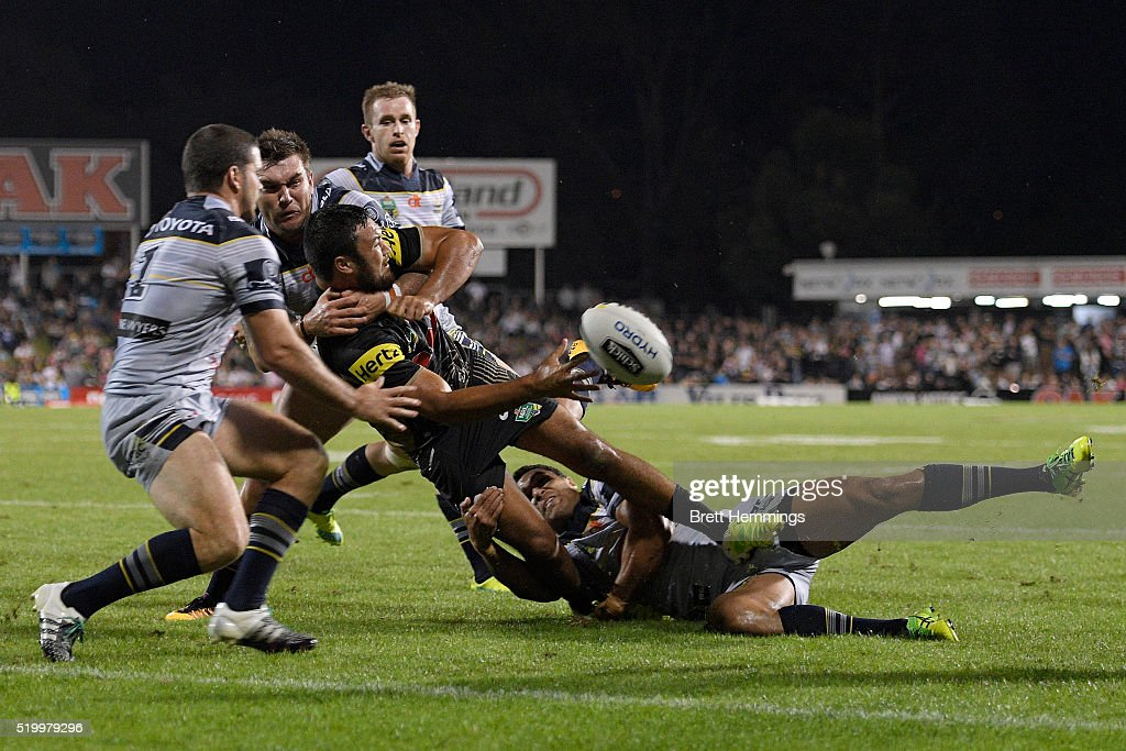 Peta Hiku of the Panthers off loads the ball in a tackle during the round six NRL match between the Penrith Panthers and the North Queensland Cowboys at Pepper Stadium on April 9, 2016 in Sydney, Australia.