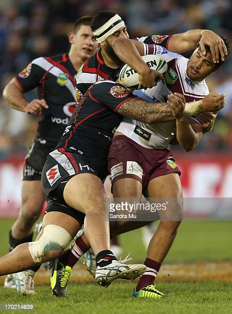 Peta Hiku of the Sea Eagles is tackled during the round 13 NRL match between the New Zealand Warriors and the Manly Sea Eagles at Mt Smart Stadium on...