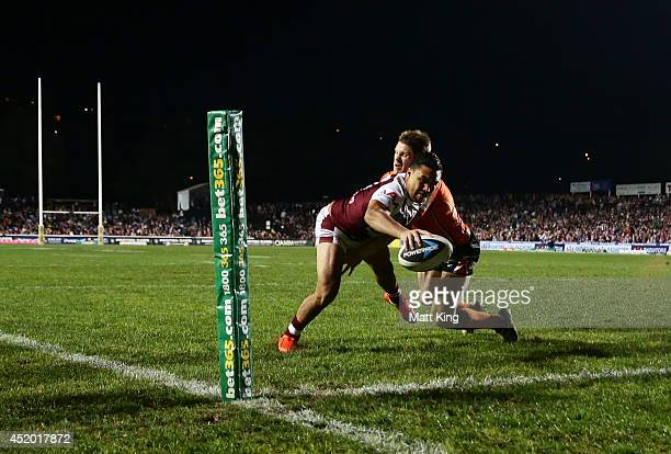 Peta Hiku of the Sea Eagles scores a try in the corner during the round 18 NRL match between the Manly Warringah Sea Eagles and the Wests Tigers at...