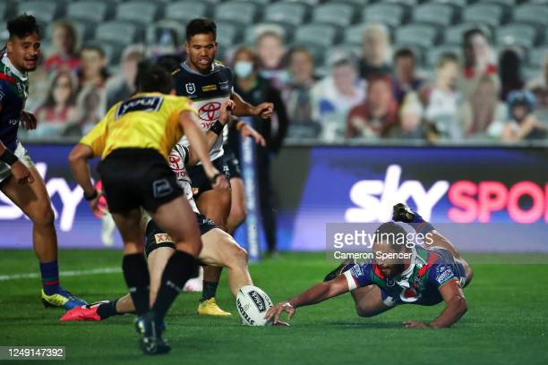 Peta Hiku of the Warriors scores a try during the round five NRL match between the New Zealand Warriors and the North Queensland Cowboys at Central...