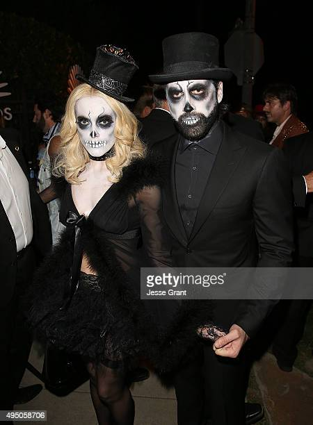Peta Murgatroyd and Maksim Chmerkovskiy arrive at the Casamigos Tequila Halloween Party on October 30 2015 in Los Angeles California