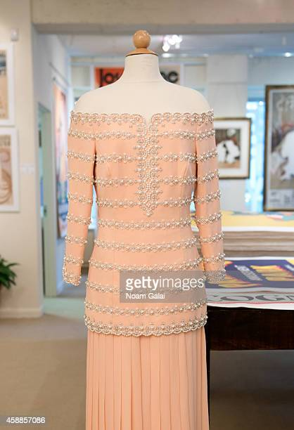 A petal pink silk Catherine Walker gown double worn by HRH Princess Diana to the reopening of the Savoy theatre and to a performance of La boheme at...