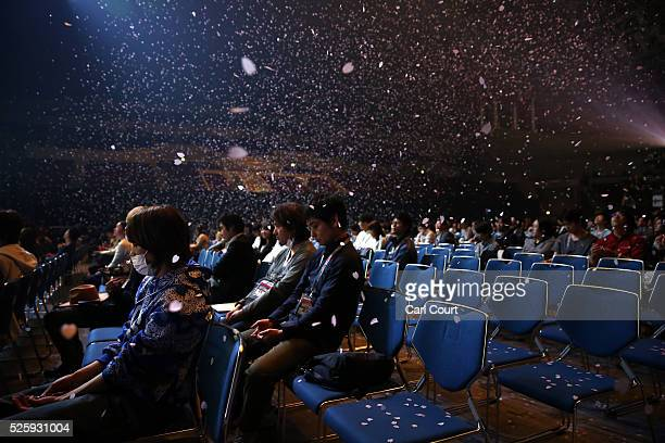 Petals fall on the audience after the final dress rehearsal for the kabuki theatre show 'Hanakurabe Senbonzakura' on April 28 2016 in Tokyo Japan The...