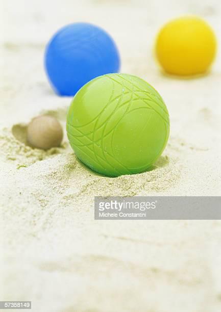 Petanque balls in sand
