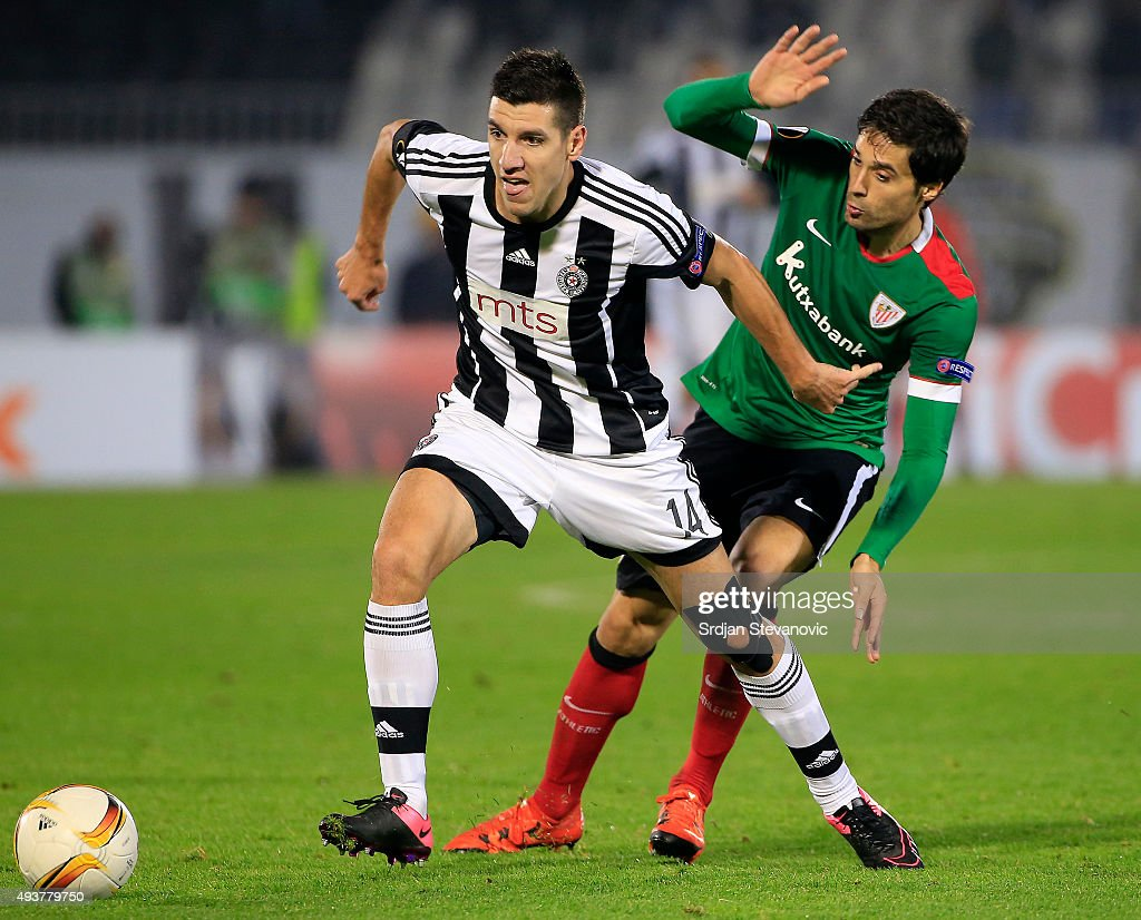 Petar Grbic (L) of FK Partizan in action against Aymeric Laporte (R) of Athletic Club during the UEFA Europa League match between FK Partizan v Athletic Club at Stadium FK Partizan on October 22, 2015 in Belgrade, Serbia.