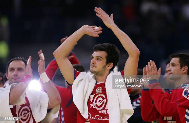 Petar Nenadic and Alem Toskic of Serbia look dejected after the match during the Men's European Handball Championship 2012 final match between Serbia...