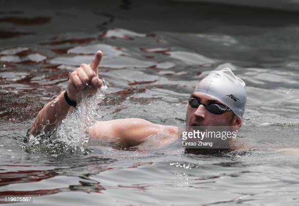 Petar Stoychev of Bulgaria celebrates as he wins gold in the Men's Open Water 25km during Day Eight of the 14th FINA World Championships at the...