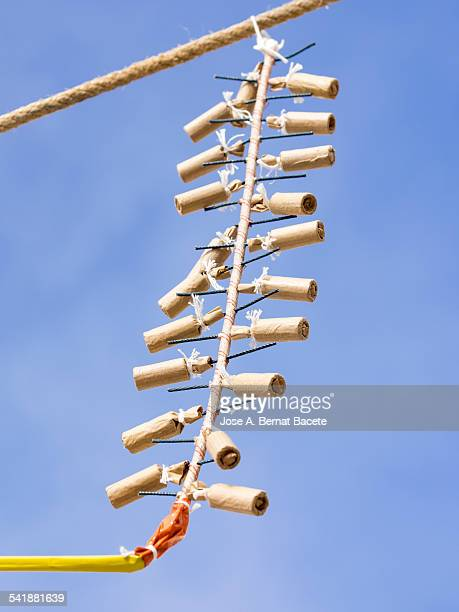 Petards and hung rockets of a rope