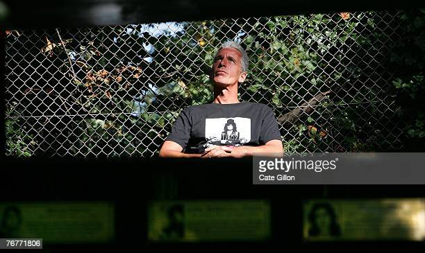 Pete, a fan from Preston listens to music as he pays tribute to Marc Bolan, lead-singer & guitarist of the band T-Rex, by visiting his roadside...
