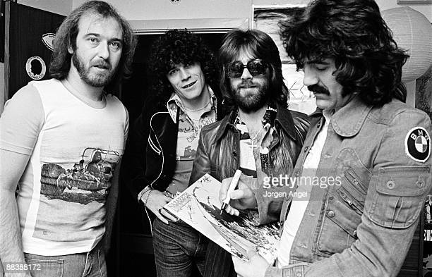 Pete Agnew Dan McCafferty Darrell Sweet and Manny Charlton of the Scottish rock band Nazareth posing for a group shot and singning autographs in...