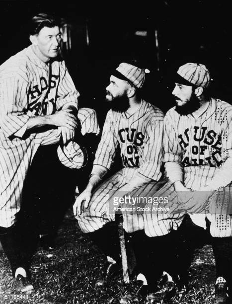 Pete Alexander also known as Grover Cleveland Alexander the playing manager of the House of David baseball team takes with two of his players...