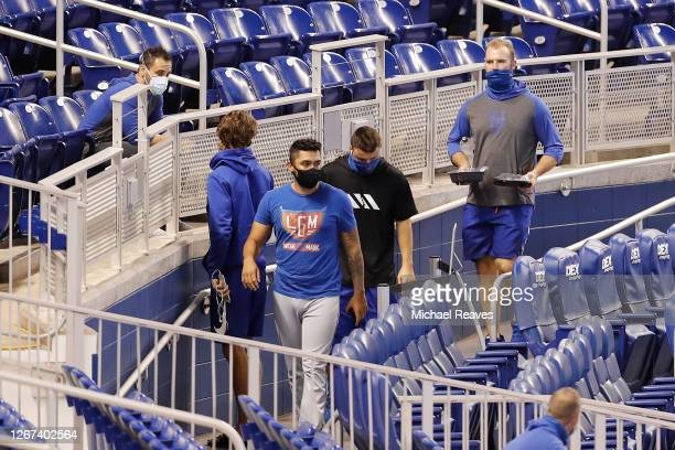 Pete Alonso and Ali Sanchez of the New York Mets walk to the clubhouse after the game between the New York Mets and the Miami Marlins was postponed...