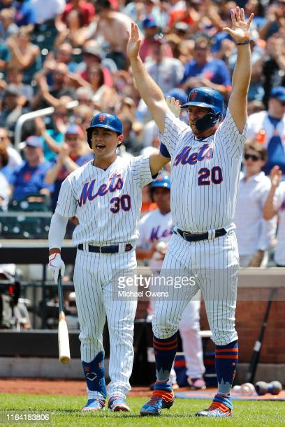 Pete Alonso and Michael Conforto of the New York Mets react after Todd Frazier hit a double to left center against the San Diego Padres at Citi Field...