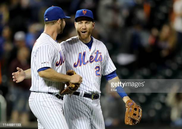 Pete Alonso and Todd Frazier of the New York Mets celebrate the win over the Philadelphia Phillies at Citi Field on April 23 2019 in the Flushing...