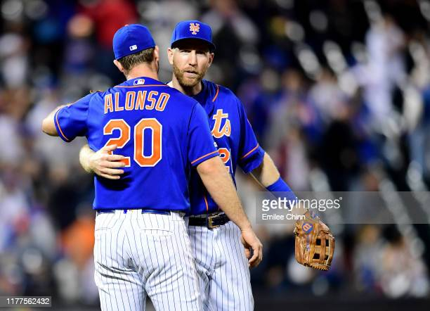 Pete Alonso and Todd Frazier of the New York Mets celebrate their 42 win over the Atlanta Braves at Citi Field on September 27 2019 in the Flushing...