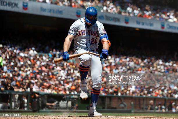 Pete Alonso of the New York Mets breaks his bat over his knee after striking out against the San Francisco Giants during the third inning at Oracle...