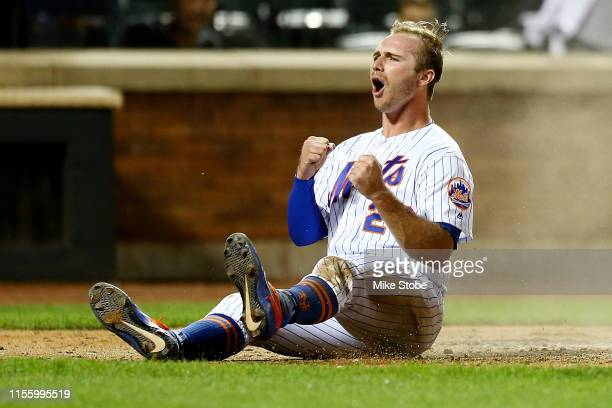 Pete Alonso of the New York Mets celebrates after scoring on Wilson Ramos tworun single in the seventh inning against the St Louis Cardinals at Citi...