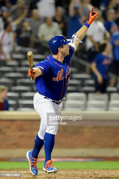 Pete Alonso of the New York Mets celebrates as he watches his seventh inning home run against the Miami Marlins at Citi Field on August 05 2019 in...