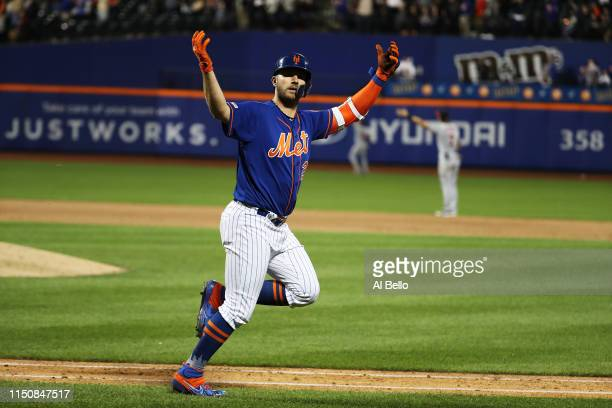Pete Alonso of the New York Mets celebrates his eighth inning solo home run against the Washington Nationals during their game at Citi Field on May...