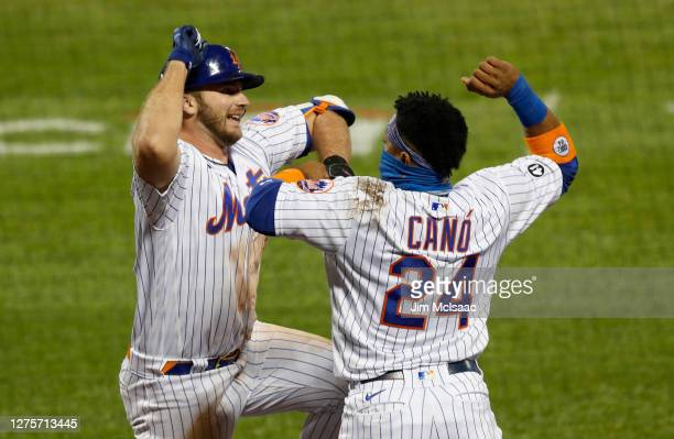 Pete Alonso of the New York Mets celebrates his fourth inning home run against the Tampa Bay Rays with teammate Robinson Cano at Citi Field on...