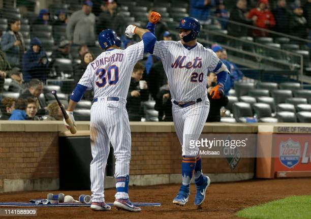 Pete Alonso of the New York Mets celebrates his seventh inning home run against the Minnesota Twins with teammate Michael Conforto at Citi Field on...