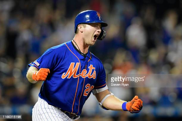 Pete Alonso of the New York Mets celebrates his seventh inning gamewinning home run against the Miami Marlins at Citi Field on August 05 2019 in New...