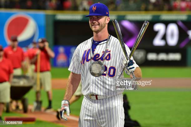 Pete Alonso of the New York Mets celebrates winning the TMobile Home Run Derby at Progressive Field on July 08 2019 in Cleveland Ohio